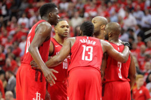 The Houston Rockets players huddle on the court during a timeout against the Utah Jazz in game five of the first round of the 2019 NBA Playoffs at Toyota Center. Credit: Erik Williams-USA TODAY Sports
