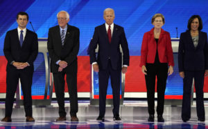 South Bend Mayor Pete Buttigieg, Senator Bernie Sanders, former Vice President Joe Biden, Senator Elizabeth Warren and Senator Kamala Harris pose before the start of the third 2020 Democratic U.S. presidential debate in Houston, Texas, U.S. Photo by Mike Blake/Reuters.