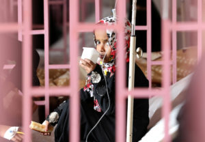 A girl looks from behind bars as she sits on bed at al-Sabeen hospital where she receives treatment in Sanaa, Yemen on September 14, 2019. Photo by Khaled Abdullah/Reuters
