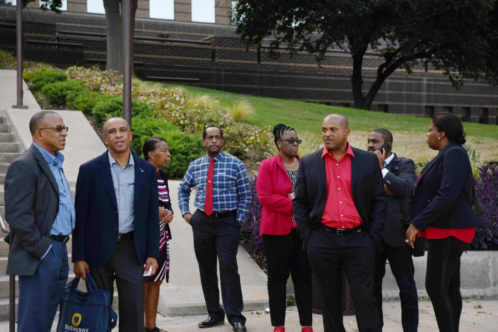 Botham Jean's family stands outside the Frank Crowley Courts Building after the first day of deliberations in the trial of former Dallas police officer Amber Guyger, who is charged in the killing of Botham Jean in his own home, in Dallas, Texas, on September 30, 2019. Photo by Jeremy Lock/Reuters