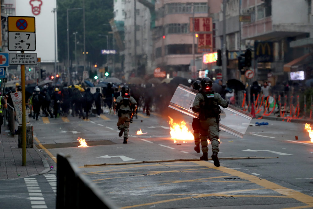 Riot police advance during a protest in Sham Shui Po district, on China's National Day in Hong Kong, China on October 1, 2019. Photo by Athit Perawongmetha/Reuters