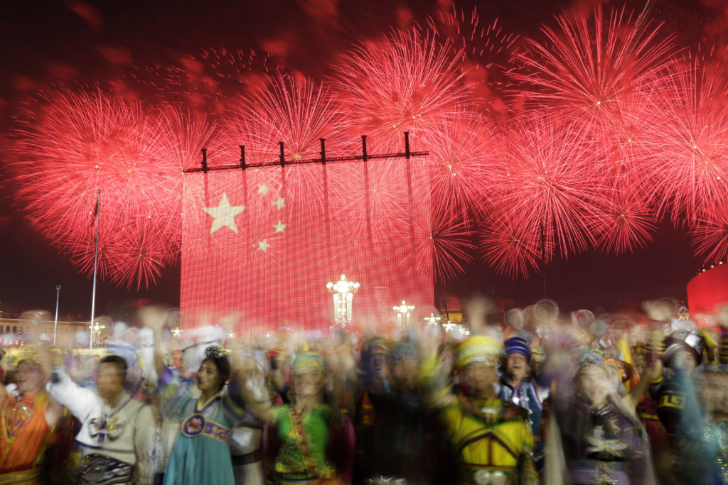 Fireworks explode over Tiananmen Square as performers take part in the evening gala marking the 70th founding anniversary of People's Republic of China, on its National Day in Beijing, China October 1, 2019. Picture taken with slow shutter speed. Photo by Jason Lee/Reuters