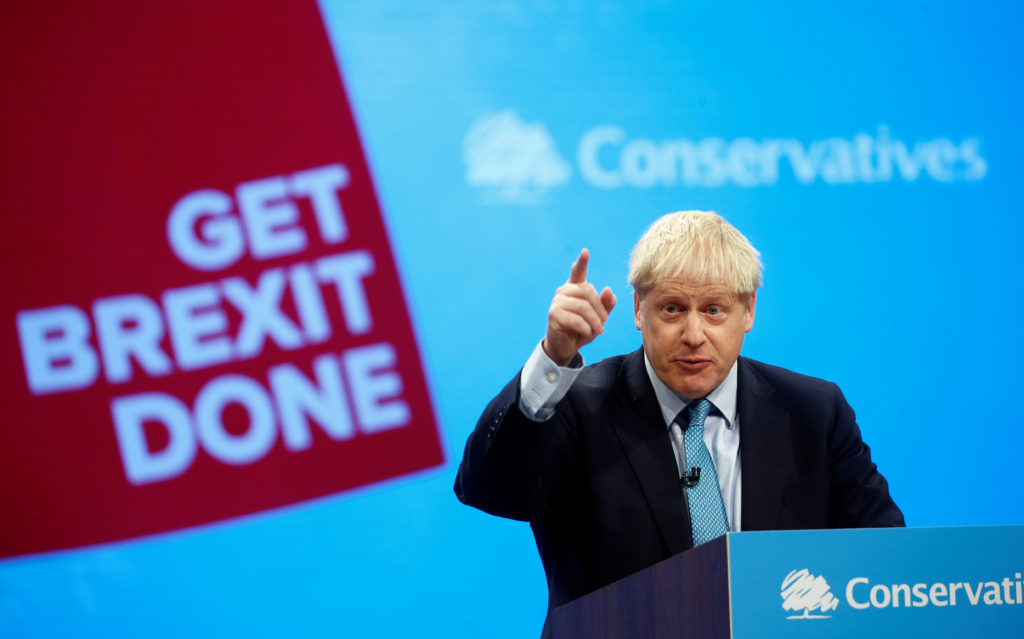 Britain's Prime Minister Boris Johnson gestures as he gives a closing speech at the Conservative Party annual conference in Manchester, Britain, October 2, 2019. Photo by Henry Nicholls/Reuters