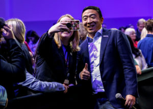 U.S. Democratic presidential candidate and businessman Andrew Yang poses for a selfie during a forum held by gun safety organizations the Giffords group and March For Our Lives in Las Vegas, Nevada, October 2, 2019. Photo by Steve Marcus/Reuters