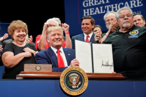 U.S. President Donald Trump holds up an executive order on Medicare he signed during an event at The Villages retirement community in The Villages, Florida, October 3, 2019. Photo by Kevin Lamarque/Reuters