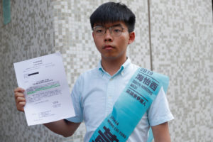 Joshua Wong, secretary-general of Hong Kong's pro-democracy Demosisto party, poses before submitting his application for the race in the 2019 District Council Election, at the Southern District Office in Hong Kong, China, October 4, 2019. Photo by Susana Vera/Reuters