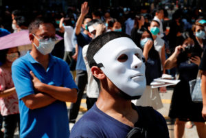 Anti-government office workers wearing masks attend a lunch time protest, after local media reported on an expected ban on face masks under emergency law, at Central, in Hong Kong, China, October 4, 2019. Photo by Tyrone Siu/Reuters