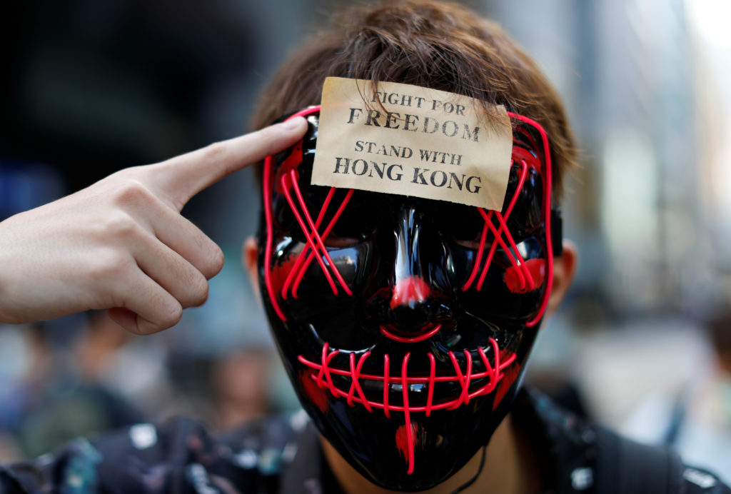 A masked anti-government protester is pictured in Central Hong Kong, China October 4, 2019. Photo by Jorge Silva/Reuters