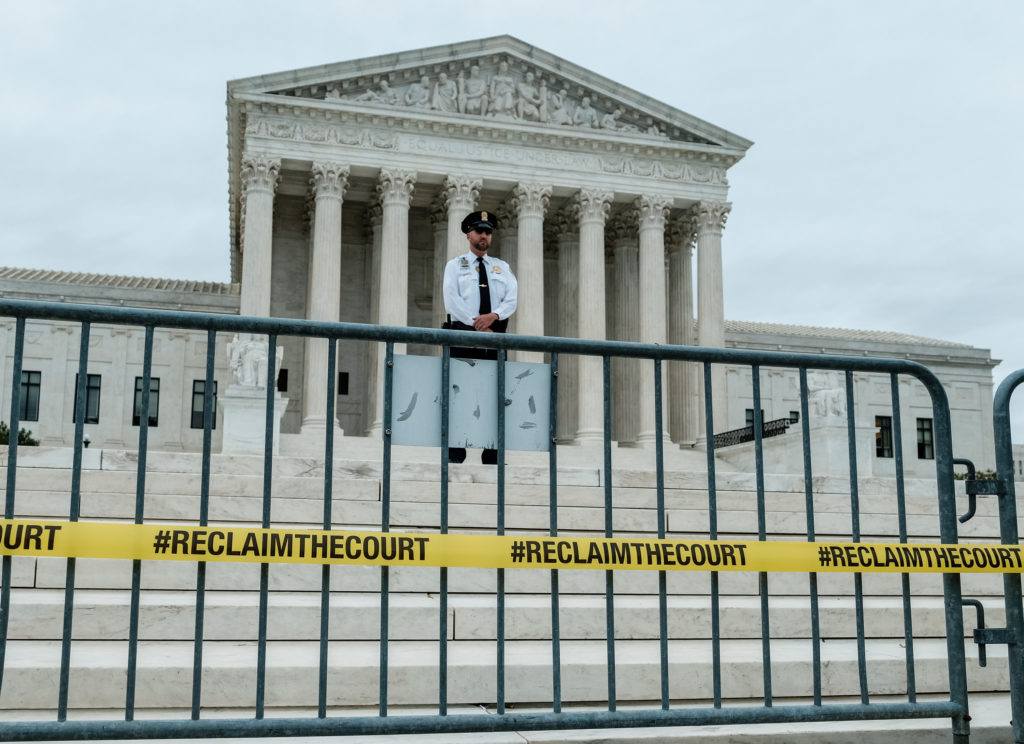 A U.S. Supreme Court Police officer stands guard outside of the U.S. Supreme Court one day before the start of its new ter...