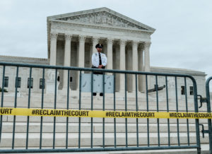 A U.S. Supreme Court Police officer stands guard outside of the U.S. Supreme Court one day before the start of its new term in Washington, U.S., October 6, 2019. Photo by Michael A. McCoy/Reuters