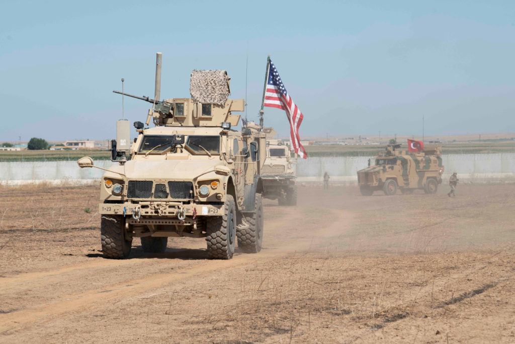 FILE PHOTO: U.S. and Turkish military forces conduct a joint ground patrol inside the security mechanism area in northeast, Syria, September 8, 2019. Picture taken September 8, 2019. U.S. Army/Spc. Alec Dionne/Handout via Reuters