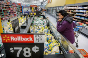 FILE PHOTO: A customer shops for a turkey at a Walmart store in Chicago, Illinois, U.S., November 20, 2018. Photo by Kamil Krzaczynski/Reuters