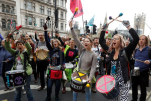 Extinction Rebellion protesters play on drums and shout slogans as they demonstrate in Westminster, London, Britain October 7, 2019. Photo by Peter Nicholls/REuters
