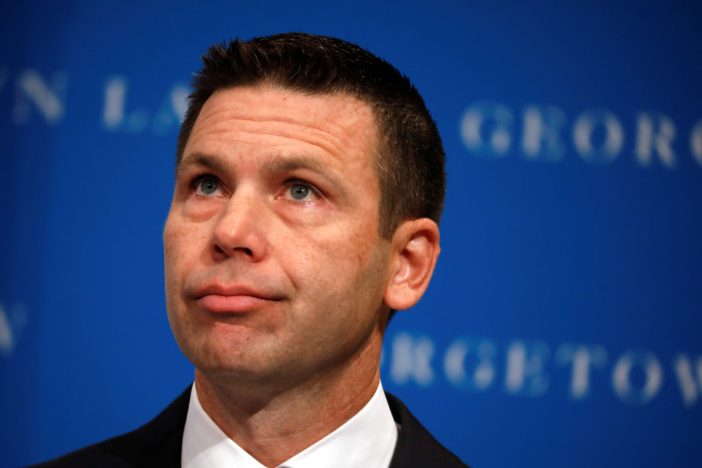 Acting Department of Homeland Security (DHS) Secretary Kevin McAleenan reacts while protesters interrupt his remarks at th...