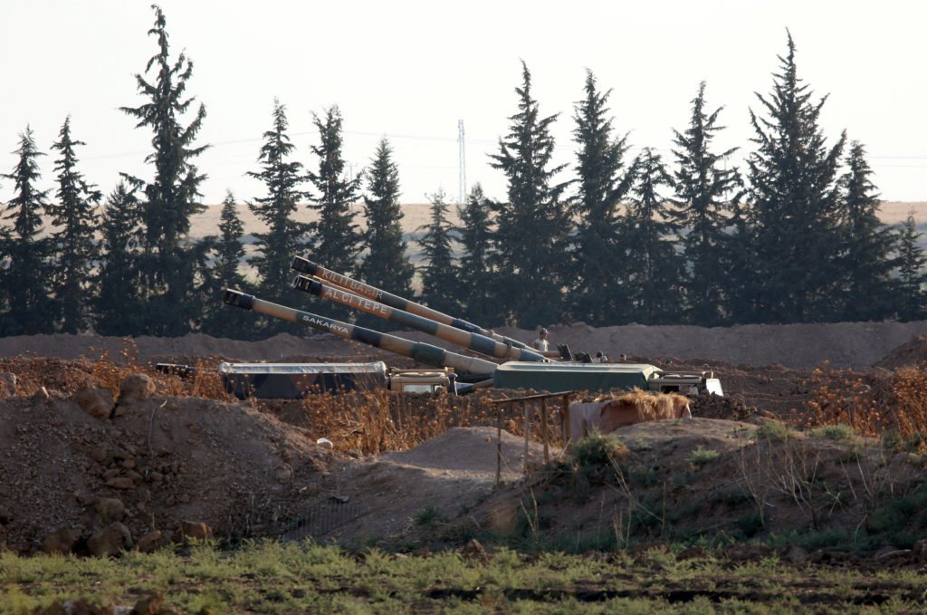 Turkish army howitzers are positioned on the Turkish-Syrian border,…