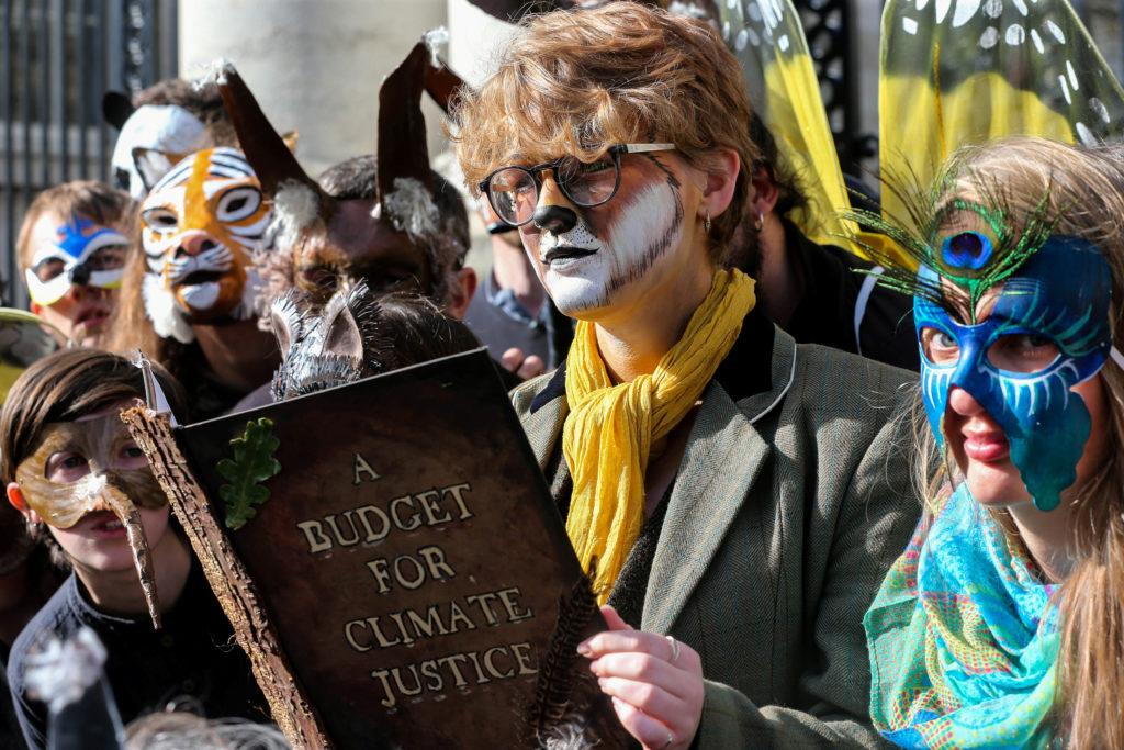 Extinction Rebellion protestor Leontien Friel Darrell reads a Budge…