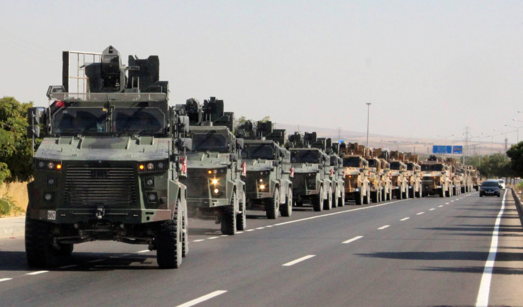 A Turkish miltary convoy is pictured in Kilis near the Turkish-Syrian border, Turkey, October 9, 2019. Photo by Mehmet Ali...