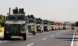 A Turkish miltary convoy is pictured in Kilis near the Turkish-Syrian border, Turkey, October 9, 2019. Photo by Mehmet Ali Dag/ Ihlas News Agency (IHA) via Reuters