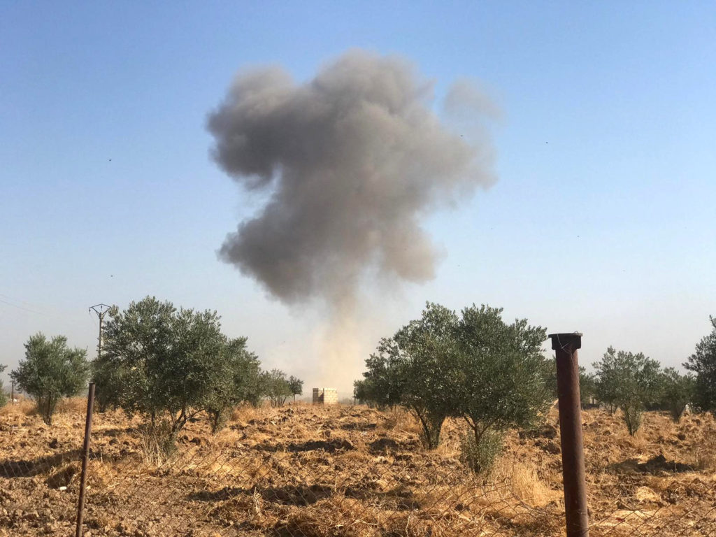 Smoke rises from Tel Arkam village in Ras al Ain countryside, Syria on October 10, 2019. Photo by Stringer via Reuters
