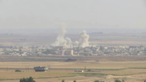 Smoke billows out after Turkish shelling on the Syrian border town of Ras Al Ain, as seen from Ceylanpinar, Turkey, October 11, 2019 in this still image taken from a video. Photo by ReutersTV
