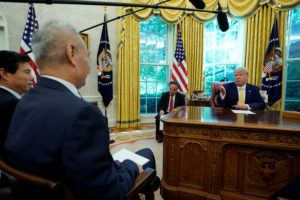 U.S. President Donald Trump talks to China's Vice Premier Liu He during their meeting in the Oval Office of the White House after two days of trade negotiations in Washington, U.S., October 11, 2019. Photo by Yuri Gripas/Reuters