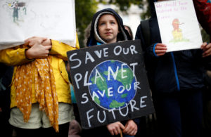 A child carries a sign during an Extinction Rebellion demonstration in London, Britain, October 12, 2019. Photo by Henry Nicholls/Reuters