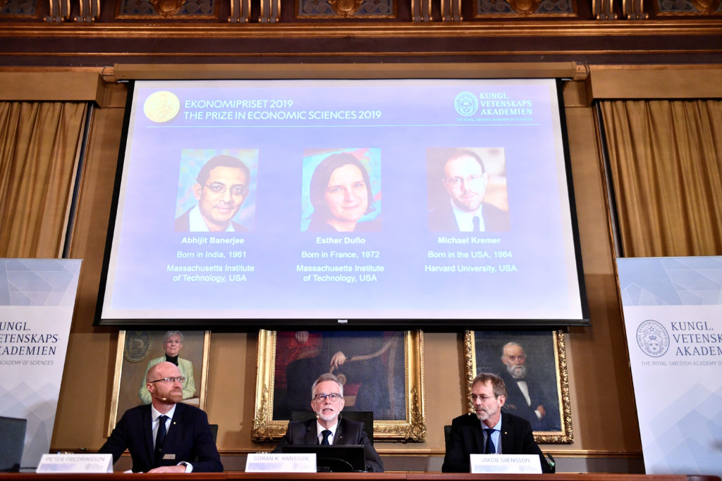 Goran K Hansson (C), Secretary General of the Royal Swedish Academy of Sciences, and academy members Peter Fredriksson (L) and Jakob Svensson, announce the winners of the 2019 Nobel Prize in Economics during a news conference at the Royal Swedish Academy of Sciences in Stockholm, Sweden, October 14, 2019. Abhijit Banerjee, Esther Duflo, and Michael Kremer received the Nobel Prize in Economics. Photo by Karin Wesslen/TT News Agency/via Reuters