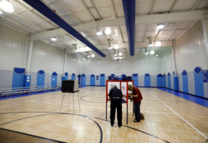 FILE PHOTO: Voters cast their ballots at one of two polling booths placed at the basketball court during the special election for North Carolina's 9th Congressional District, at a local community center in Monroe, North Carolina, U.S., September 10, 2019. REUTERS/Jonathan Drake/File Photo