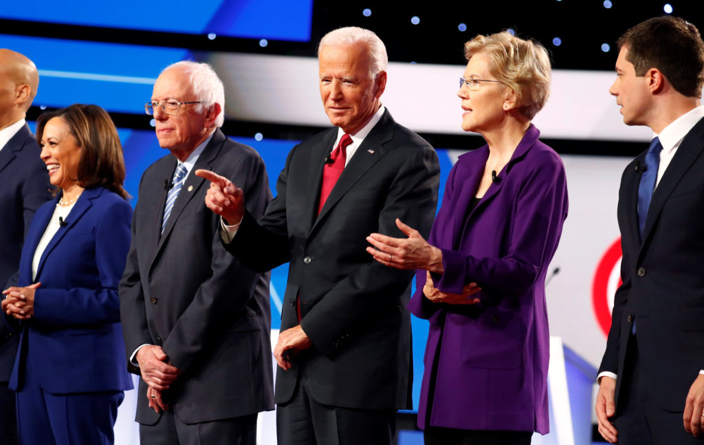 FILE PHOTO: Senator Kamala Harris, Senator Bernie Sanders, former Vice President Joe Biden, Senator Elizabeth Warren and South Bend Mayor Pete Buttigieg wait onstage before the fourth Democratic U.S. 2020 presidential election debate at Otterbein University in Westerville, Ohio October 15, 2019. REUTERS/Aaron Josefcz/File Photo