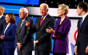 FILE PHOTO: Senator Kamala Harris, Senator Bernie Sanders, former Vice President Joe Biden, Senator Elizabeth Warren and South Bend Mayor Pete Buttigieg wait onstage before the fourth Democratic U.S. 2020 presidential election debate at Otterbein University in Westerville, Ohio October 15, 2019. Photo by Aaron Josefcz/Reuters