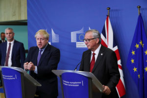Britain's Brexit Secretary Stephen Barclay, European Commission President Jean-Claude Juncker and Britain's Prime Minister Boris Johnson attend a news conference after agreeing on the Brexit deal, at the sidelines of the European Union leaders summit, in Brussels, Belgium October 17, 2019. Photo by Yves Herman/Reuters