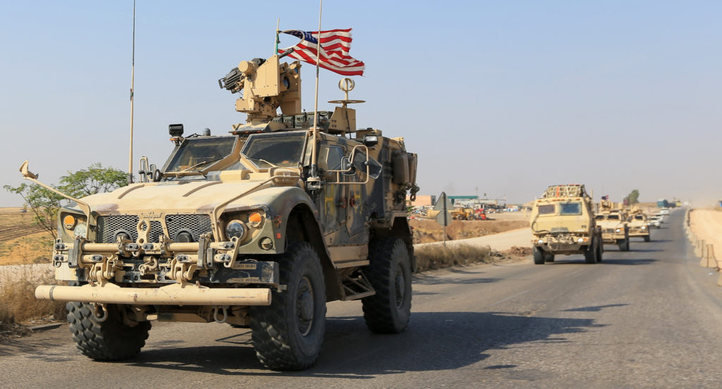 A convoy of U.S. vehicles is seen after withdrawing from northern S…