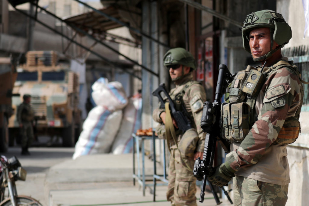 Turkish soldiers stand guard in the town of Tal Abyad, Syria Octobe…