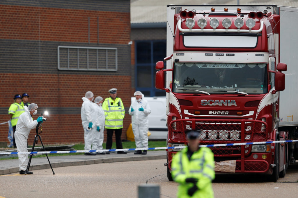 Police are seen at the scene where bodies were discovered in a lorry container, in Grays, Essex, Britain October 23, 2019....