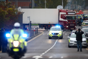 Police move the truck container where bodies were discovered, in Gr…