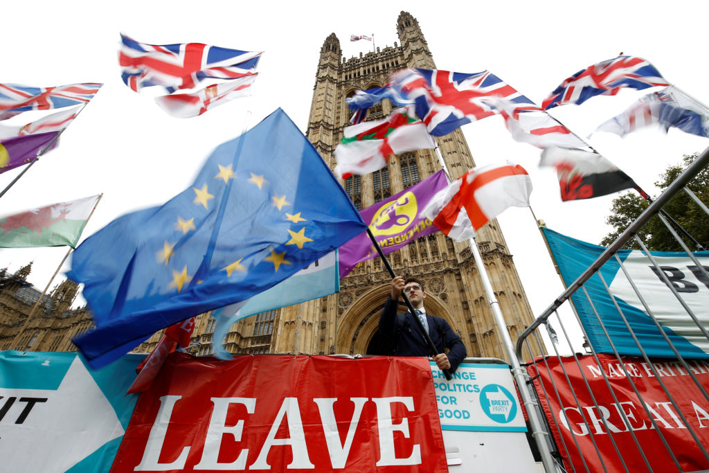 An anti-Brexit protester waves an EU flag outside the Houses ofParliamentin London, Britain, October 25, 2019. Photo by Henry Nicholls