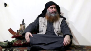 A bearded man with Islamic State leader Abu Bakr al-Baghdadi's appearance speaks in this screen grab taken from video released on April 29, 2019. Islamic State Group/Al Furqan Media Network/Reuters TV