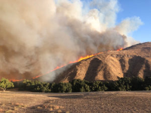 Fire is seen in Simi Valley, California, U.S. October 30, 2019, in this social media image. Courtesy of Twitter @415FirePhoto/Social Media via Reuters