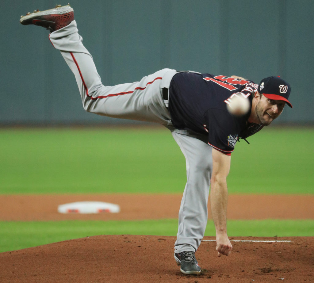 Washington Nationals pitcher Max Scherzer (31) throws a pitch against the Houston Astros during the first inning in game seven of the 2019 World Series at Minute Maid Park. Mandatory Credit: Mike Ehrmann/Pool Photo via USA TODAY Sports