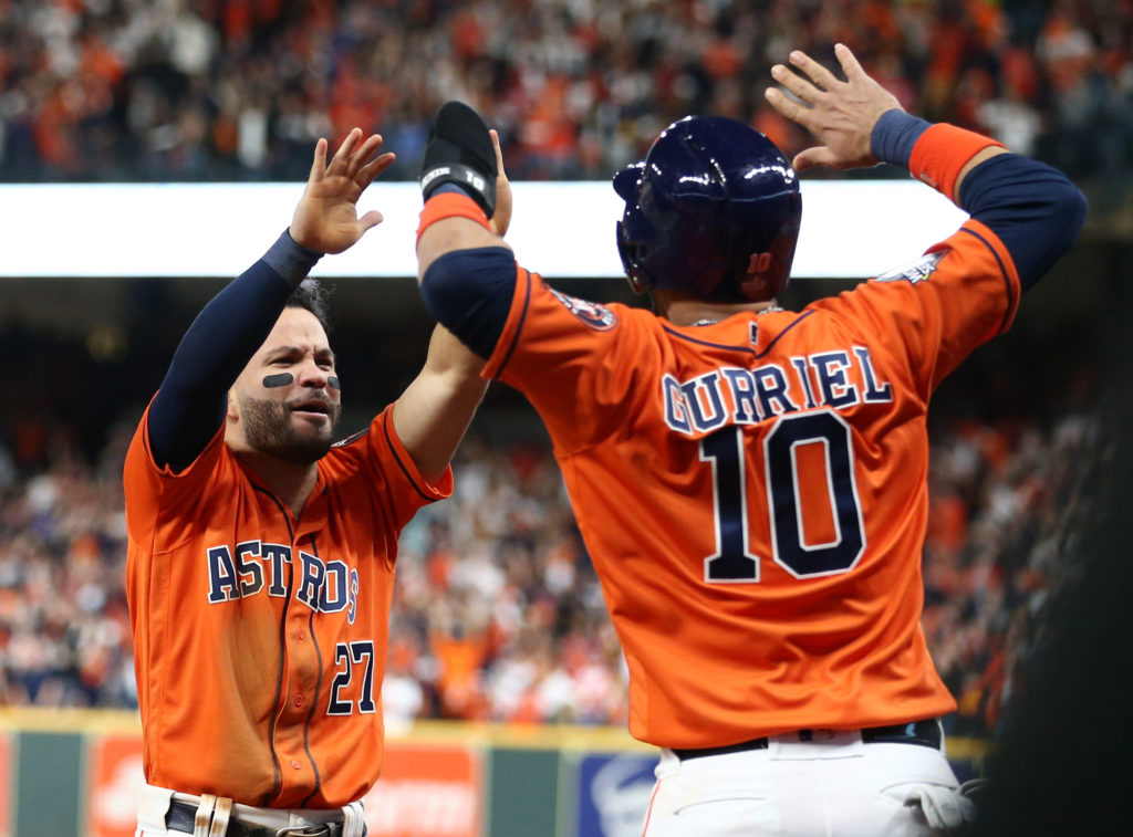 Houston Astros first baseman Yuli Gurriel (10) celebrates with second baseman Jose Altuve (27) after scoring a run against the Washington Nationals during the fifth inning in game seven of the 2019 World Series at Minute Maid Park. Mandatory Credit: Troy Taormina-USA TODAY Sports