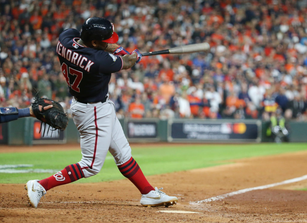 Washington Nationals designated hitter Howie Kendrick hits an infield single during the eighth inning in game seven of the 2019 World Series at Minute Maid Park. Mandatory Credit: Troy Taormina-USA TODAY Sports