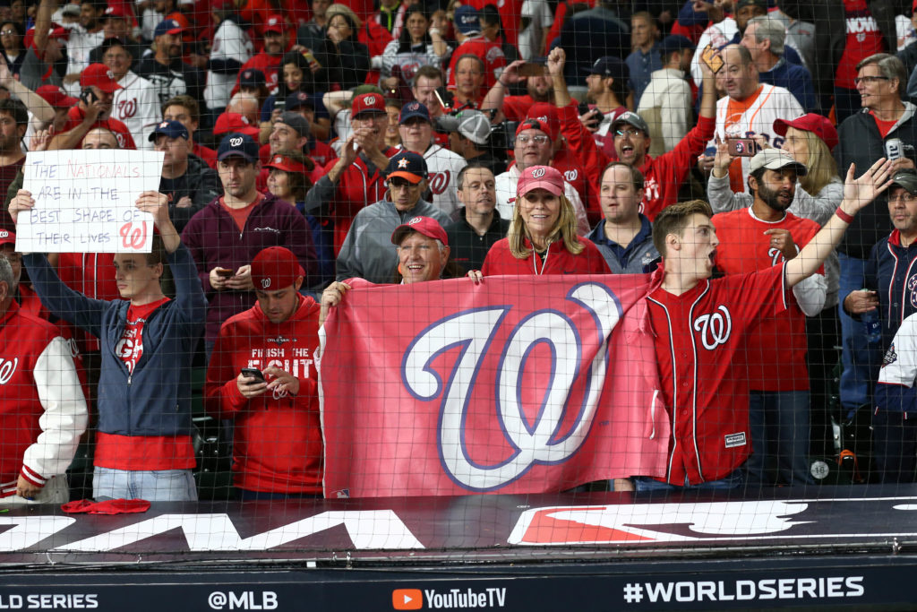 Washington Nationals fans celebrate after the Nationals defeated the Houston Astros in game seven of the 2019 World Series at Minute Maid Park. The Washington Nationals won the World Series winning four games to three. Mandatory Credit: Troy Taormina-USA TODAY Sports