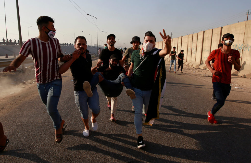 News Wrap: Iraqi security forces kill at least 12 more protesters