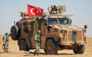 A Turkish soldier walks next to a Turkish military vehicle during a joint U.S.-Turkey patrol, near Tel Abyad, Syria September 8, 2019. Photo by Rodi Said/Reuters