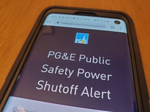 Close-up of cellphone displaying alert from utility Pacific Gas and Electric warning of an unprecedented Public Safety Power Shutoff, or planned power outage to reduce wildfire risk, which would leave much of the San Francisco Bay Area without electrical power, San Ramon, California, October 8, 2019. Photo by Smith Collection/Gado/Getty Images