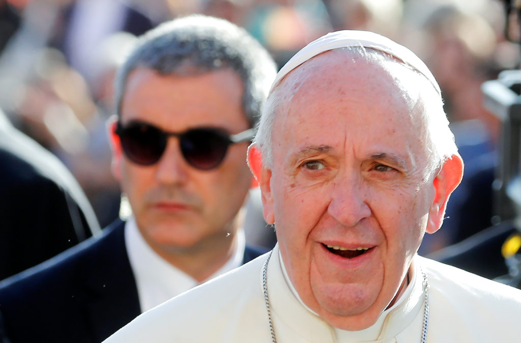 Pope Francis, flanked by newly appointed Commander of the Vatican Gendarmerie Corps Gianluca Gauzzi Broccoletti, arrives f...