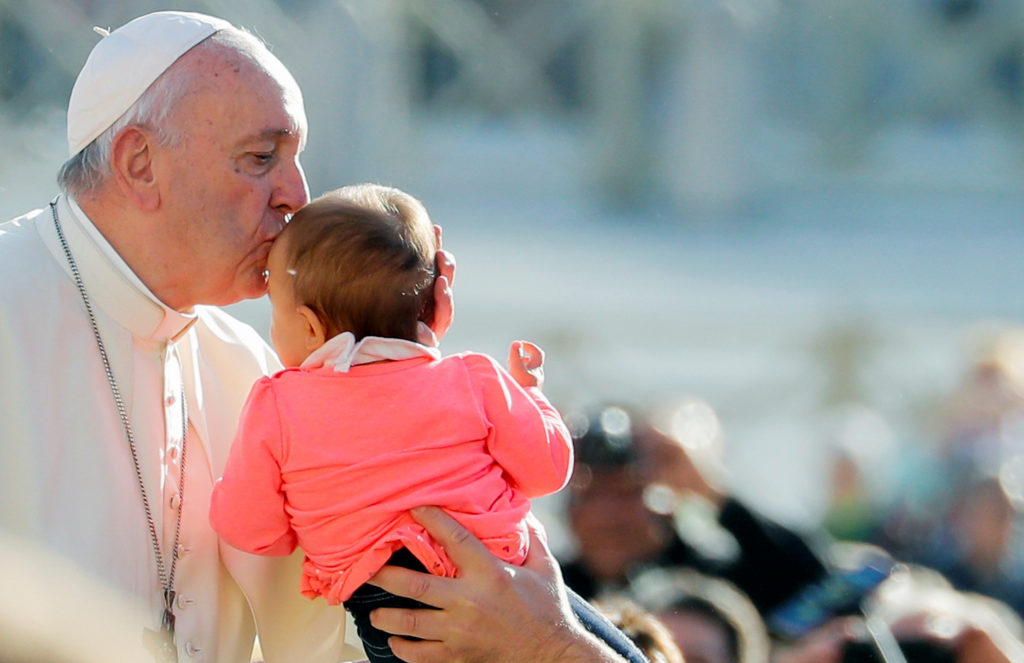 Pope Francis kisses a baby as he arrives for the weekly general audience at the Vatican, October 16, 2019. Photo by REUTERS/Remo Casilli