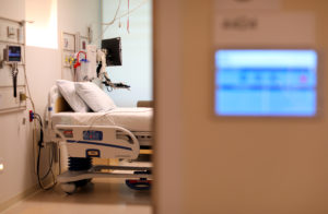 An electronic patients chart is shown on the wall to a hospital room at the newly constructed Kaiser Permanente San Diego Medical Center hospital. Photo by Mike Blake/Reuters.