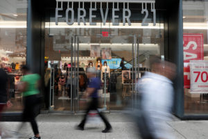 People walk by the clothing retailer Forever 21 in New York City on September 12, 2019. Photo by Shannon Stapleton/Reuters
