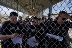 U.S. Customs and Border Protection agents call the names of asylum seekers that have a court hearing that day as a group of migrants, who returned to Mexico to await their U.S. asylum hearing, block the Puerta Mexico international border crossing bridge to demand a speedier asylum process in Matamoros, Mexico, October 10, 2019. Photo by Veronica G. Cardenas/Reuters